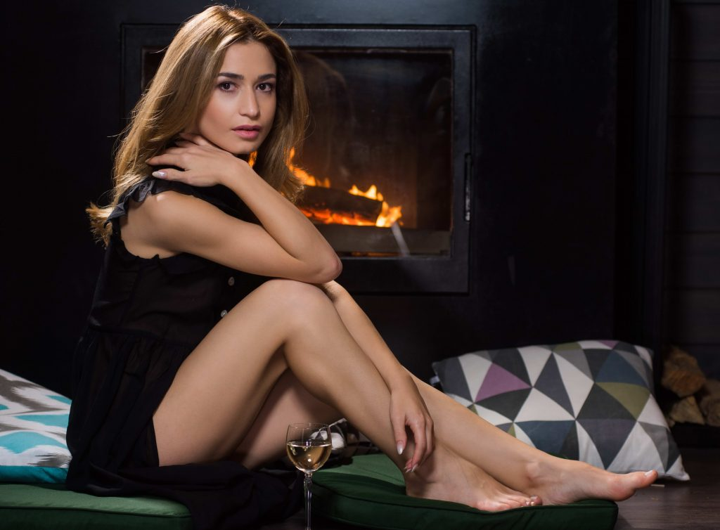 Classy Escort By The Fireplace